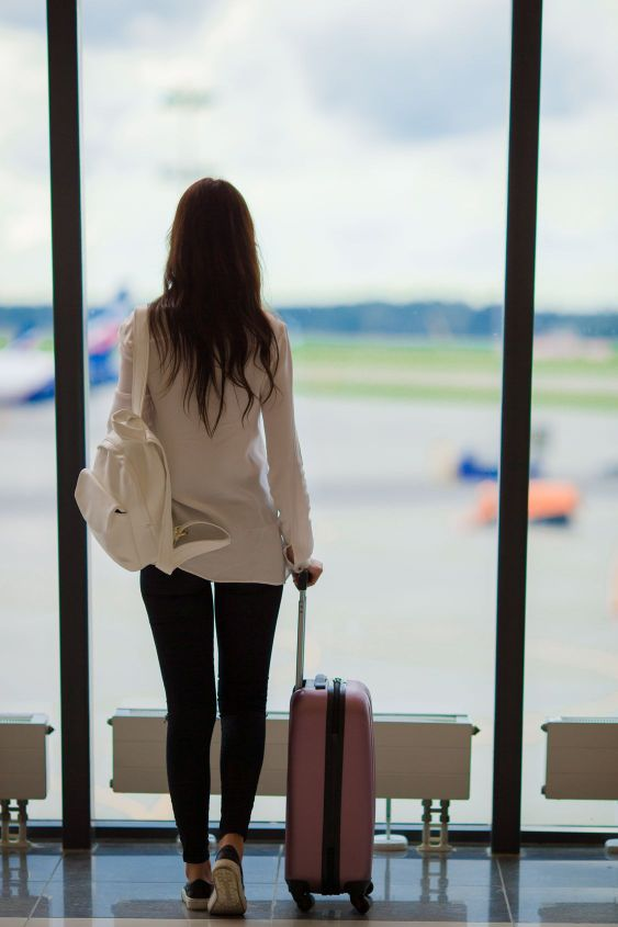 Silhouette of airline passenger in an airport lounge...