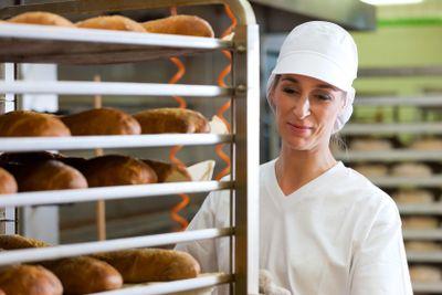 Female baker baking bread