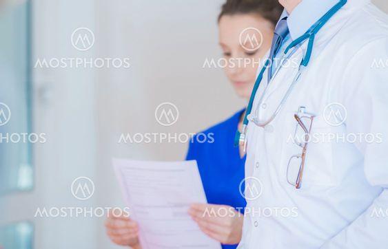 Medical Personel Inside Hospital Hallway