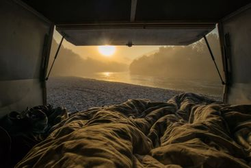 View from a bed in the vintage campervan parked on the...