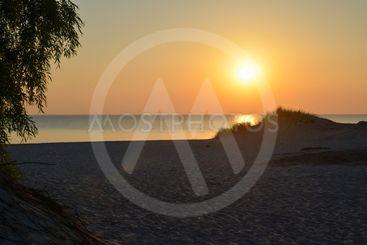 Solnedgång vid en strand på Gotland 1