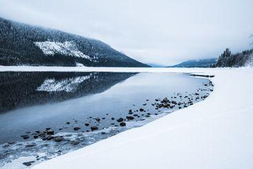 Hillside reflected in water, Norway