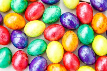 Easter eggs on wooden background. Colorful eggs in...