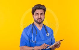 Cute Indian doctor in a blue robe with a stethoscope...