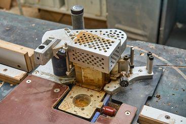 Edge banding machine in the workshop. Wooden furniture...