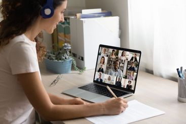 Female employee have webcam digital meeting with colleagues
