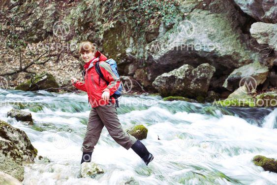 Girl crossing river