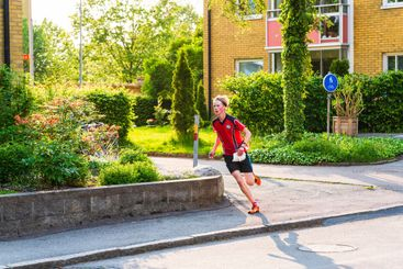 Boy running during a sprint orienteering race.