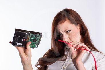 Woman Examines Hard Drive Connector