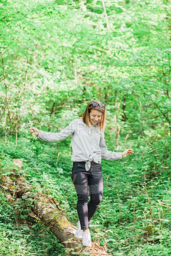 Young woman hiking through the forest