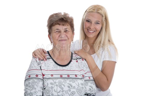 Portrait of real grandmother with her granddaughter.