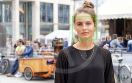young woman picked out by face detection or facial...