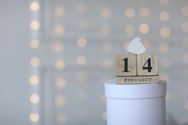 Valentine's day concept. Date 14 February on wooden cube...