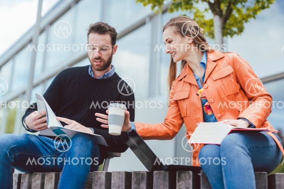 Woman and man studying together on university campus