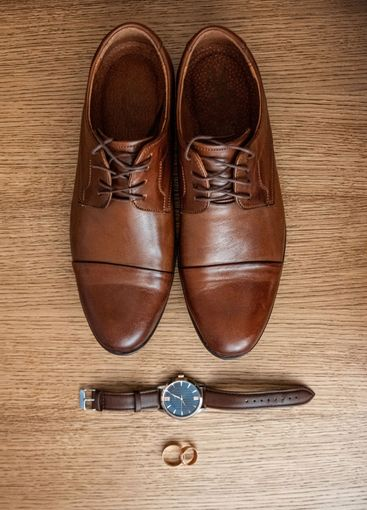 Wedding accessories, shoes, watches, rings, bow tie. The...