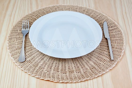 Elegant dish fork knife on braided cloth. On the texture...