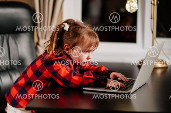 a little girl imitates her mother and works on a...