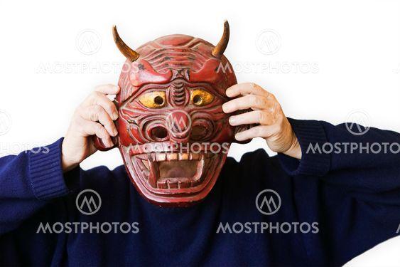 Person med op en Devil Mask