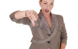 Business woman gesturing not OK with thumb down
