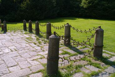 Metal fence with stone columns