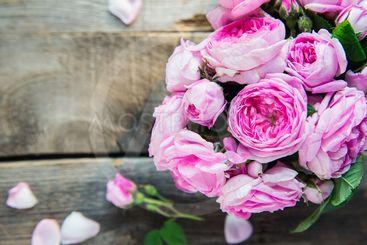Top view tender pink tea roses bouquet on vintage rustic...
