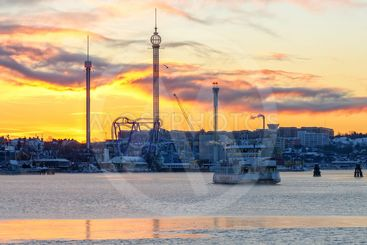Ferry departs in the cold winter morning with Grona Lund...