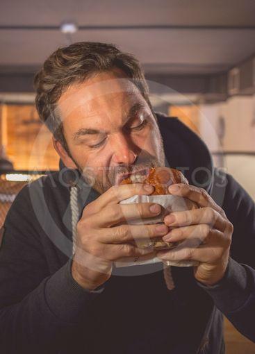 Man biting in a burger