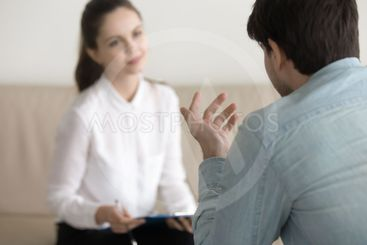Female psychologist consulting male patient, job...