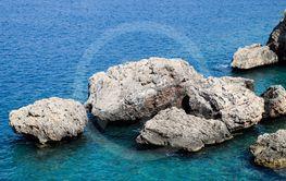 Limestone cliffs by sea. Waves beat on the rocks.