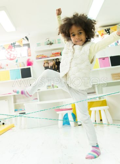Little girl in the kindergarten