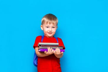 Smiling happy cute clever boy with backpack. Child with...