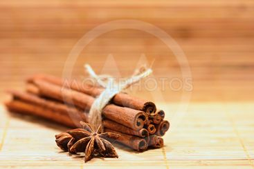 Cinnamon and star anise on a wooden background. Beautiful...