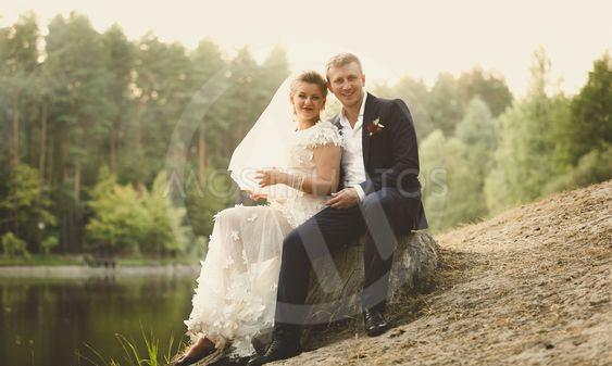 Toned photo of just married couple relaxing on the...
