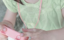 Cute little girl with a pink digital photo camera