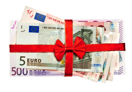 euro bills with red ribbon