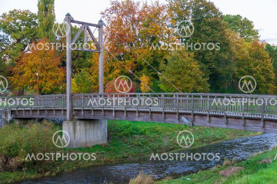 wooden suspended bridge over Mandau River