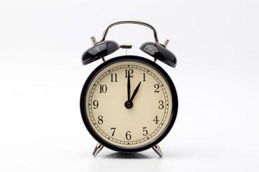 alarm clock shows one o'clock