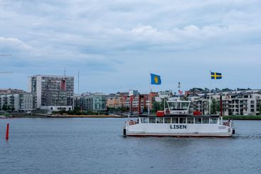 Small passenger ferry with Swedish flag