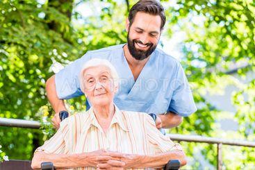 Geriatric nurse giving senior woman massage