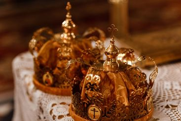 wedding Golden crowns on the table in church. Wedding...