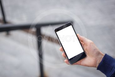 Cropped shot view of man's hands holding smart phone with...