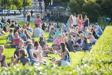 HELSINKI, FINLAND - JUNE 28, 2013: Young people resting...