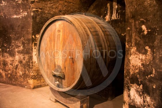 Old wooden barrel in the wine cellar of monastery
