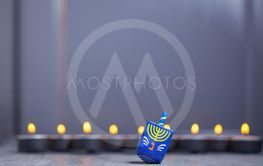 Defocused lights of Jewish holiday Hanukkah and spinning...