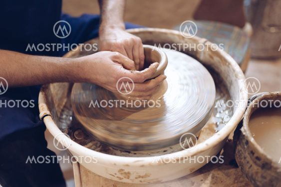 Potter making a clay vase on a potter's wheel