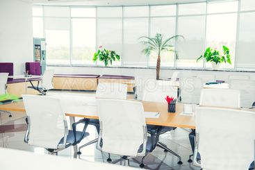 Interior of modern light empty open space office with big...