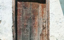 Old weathered wooden house door