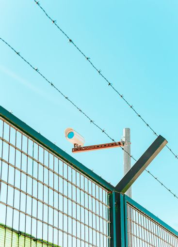 Minimalistic and colorful shot of a surveillance camera...