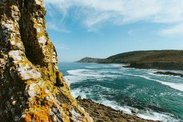 Massive seascape with the wild spanish coast at the horizon
