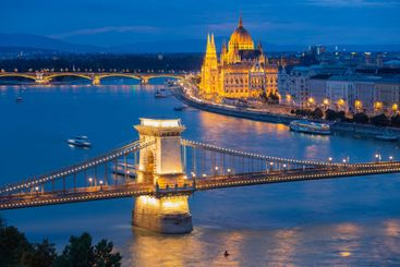 Sunset Budapest along Danube with Chain Bridge and...